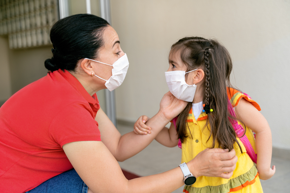 Photo of adult and child wearing masks